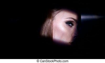 Pretty brunette woman with blue eyes artistic portrait -...