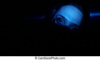 Pretty brunette woman with blue eyes artistic portrait...