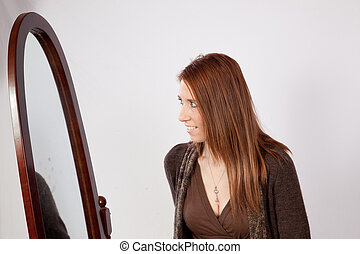 Pretty brunette woman with mirror