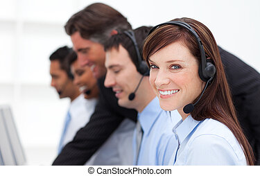 Pretty businesswoman and her team working in a call center