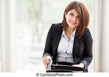 Pretty businesswoman at work