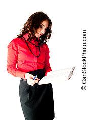 Pretty businesswoman checks organizer diary