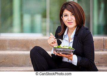 Pretty businesswoman eating healthy - Cute business woman...