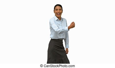 Pretty businesswoman gesturing on white screen in slow...