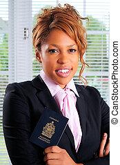 Canadian Passport - Pretty Businesswoman Holding Her...