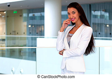 Pretty businesswoman in an office
