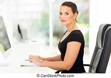 pretty businesswoman in office