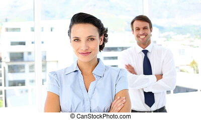 Pretty businesswoman smiling at camera