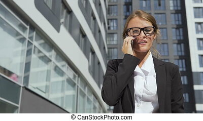 Pretty Businesswoman Talking on Phone Angrily