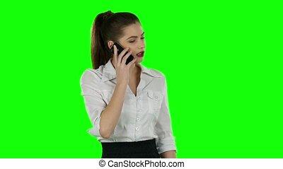 Pretty businesswoman talking on the phone. Green screen