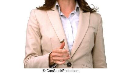 Pretty businesswoman throwing a coi