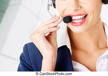 Pretty call-centre assistant smiling