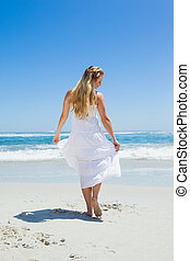 Pretty carefree blonde walking on t