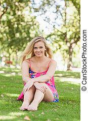 Pretty casual woman posing on a lawn