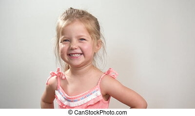 Pretty caucasian girl looking at camera and smile posing at home