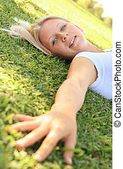 Pretty Caucasian Woman Laying On Grass Outdoor