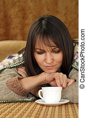 Pretty Caucasian woman on a sofa