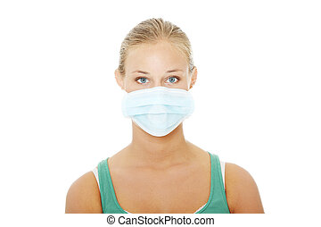 Pretty caucasian woman wearing a face mask