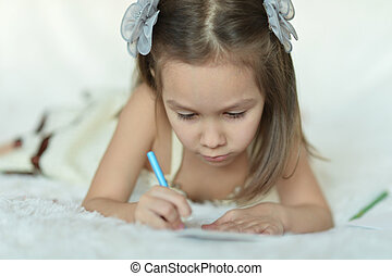 Pretty Caucasian young girl with a pencils