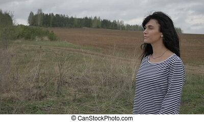 Pretty cheerful girl in field