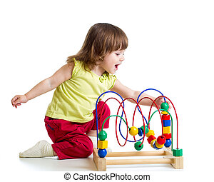 pretty child girl with color educational toy