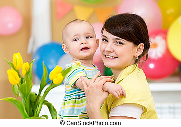 pretty child girl with mother on festive background