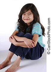 Pretty child sitting