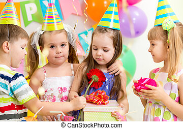 pretty children with gifts on birthday party