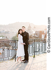https://cdn.xxl.thumbs.canstockphoto.com/pretty-chinese-bride-with-groom-on-roof-of-the-building-with-panoramic-view-of-old-city-lviv-stock-photography_csp73166002.jpg