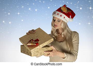 pretty christmas girl opening gift box