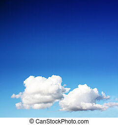 white clouds on blue sky in season