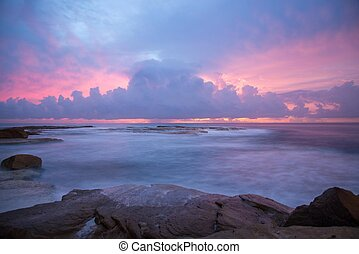 Pink and purple clouds at sunrise