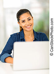 college girl using laptop computer