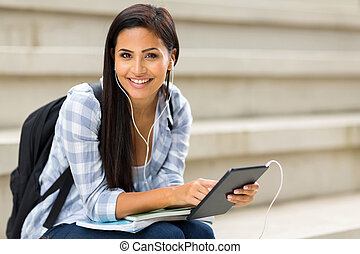 college student holding tablet computer - pretty college...