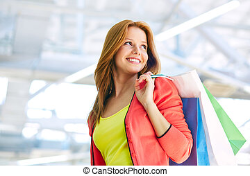 Pretty consumer - Young woman with shopping bags