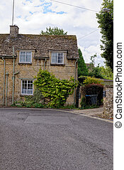 Pretty Cotswold stone cottages in the Cotswold village of Burford in Oxfordshire - United Kingdom
