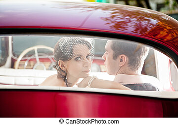 Pretty couple in the vintage car