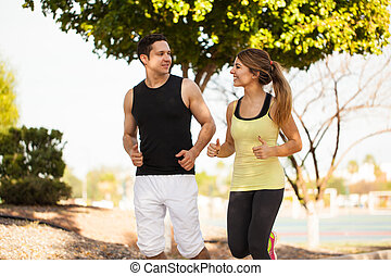 Pretty couple of runners at a park