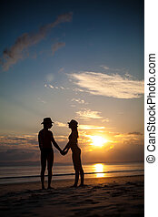 Pretty couple on the sunset background