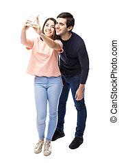 Pretty couple taking a selfie
