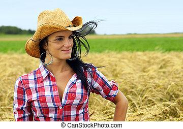 Pretty cowgirl smiling
