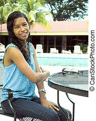 pretty Creole native Nicaraguan woman by pool hotel Managua...