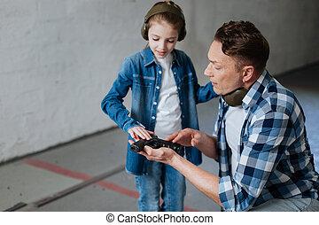 Pretty curious girl touching a handgun