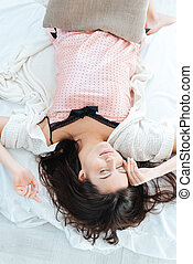 Pretty cute young woman sleeping in bed