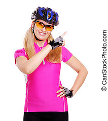 pretty cyclist girl pointing to the copy space area
