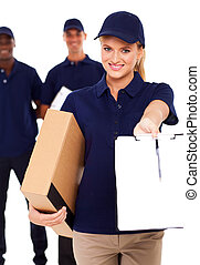 pretty delivery woman with parcel