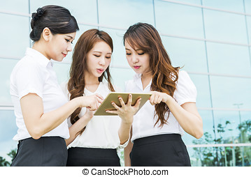 pretty diverse young business woman team at office building