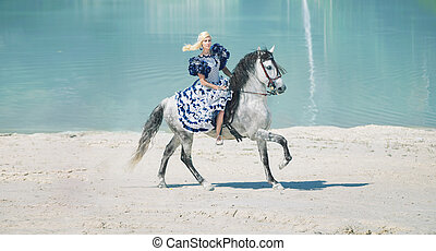 Pretty elegant lady on the horse