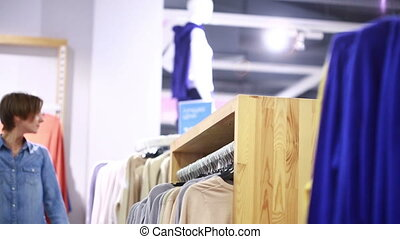 pretty elegant woman shopping in clothes store