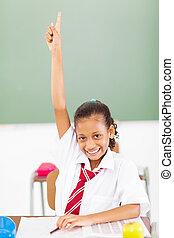 elementary schoolgirl arm up in classroom